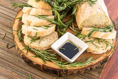Fresh baked resomary bread loaf and olive oil and balsamic vineg Royalty Free Stock Photography