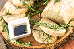 Fresh baked resomary bread loaf and olive oil and balsamic vineg Stock Photos