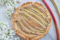 Fresh baked rhubarb tart on a table stock photos