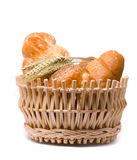 Fresh baked rolls in a basket on white Royalty Free Stock Image