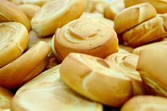 Fresh baked rolls in a industrial bakery Royalty Free Stock Photo