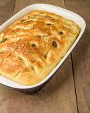 Rosemary focaccia bread in pan Royalty Free Stock Images
