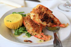 Fresh baked shrimp oreganata with lemon in netting. Large shrimp oreganata dish is a favorite in restaurants, large lemons in netting used to add flavor to this Stock Photo