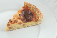 Fresh baked slice of quiche lorraine on a plate Royalty Free Stock Photos