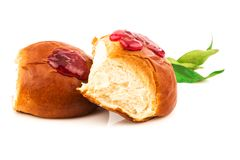 Fresh baked sweet brioches, buns, loaves, bread with tasty berri. Es jam and green leaves isolated on white background Royalty Free Stock Photo