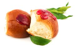 Fresh baked tasty sweet brioches, buns, loaves, bread with tasty. Berries jam and green leaves isolated on white background Stock Photography