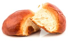 Fresh baked tasty sweet brioches, buns, loaves, bread. Isolated on white background Royalty Free Stock Image