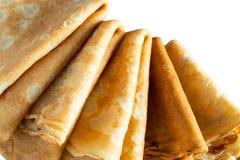 Fresh baked thin pancake on white isolated background. Food and baking royalty free stock image