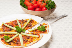 Turkish beef pizza with cucumber on top Royalty Free Stock Image