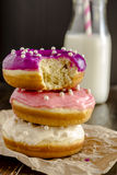 Fresh Baked Vanilla Bean Iced Doughnuts Royalty Free Stock Photography