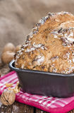 Fresh baked Walnut Bread. (close-up shot) on wooden background Royalty Free Stock Image