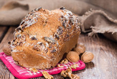 Fresh baked Walnut Bread. (close-up shot) on wooden background Stock Photos