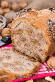 Fresh baked Walnut Bread. (close-up shot) on wooden background Royalty Free Stock Photos