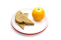 Fresh Baked Whole Wheat bread with plastic Tangerine Royalty Free Stock Photo