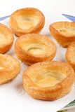 Fresh baked yorkshire pudding, british food, on a plate with kit Royalty Free Stock Photos