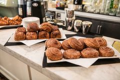 Fresh bakery assorted buns for morning coffee breakfast in the cafe. royalty free stock photography