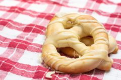 Fresh bakery pretzels isolated above white background on the wooden board royalty free stock photo