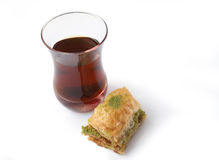 Fresh baklava and turkish tea Royalty Free Stock Photos