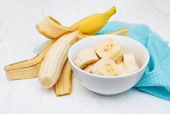 Fresh banana in a bowl. On a old white wooden background Royalty Free Stock Image
