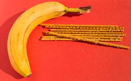 Fresh banana and salty sticks Royalty Free Stock Photography