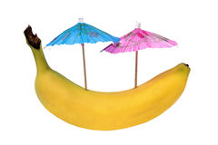 Fresh banana with umbrellas Stock Images