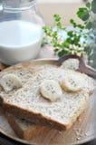 Fresh banana on wheat bread Royalty Free Stock Photos