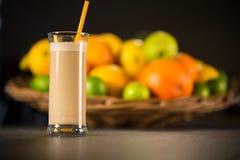 Fresh banana yogurt smoothie with fruits Stock Images