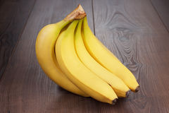 Fresh bananas on the brown table Royalty Free Stock Image
