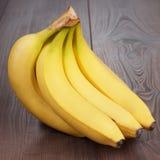 Fresh bananas on the brown table Stock Image