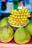 Fresh bananas and coconuts on a market Royalty Free Stock Photos