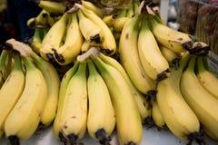 Fresh bananas. Fruit bananas background. Stack of bananas at market royalty free stock photography