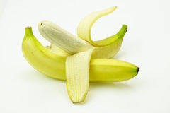 Fresh bananas one of them peeled Stock Images