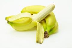 Fresh bananas one of them peeled Royalty Free Stock Images