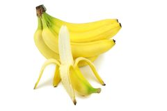 Fresh bananas and peeled banana Royalty Free Stock Photography