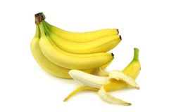 Fresh bananas and peeled banana Royalty Free Stock Image