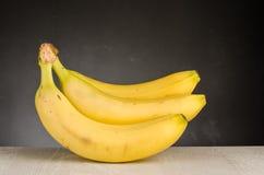 Fresh bananas on wooden background Stock Photos