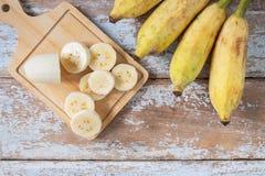 .Fresh Bananas on a Wood Background royalty free stock photo