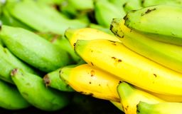 Fresh bananas on wooden background in the fruit market,Healthy food, bananas rich in vitamins, healthy lifestyle and prevention of. Vitamin deficiency Stock Photo
