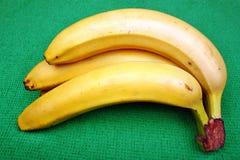 Fresh bananas on wooden board stock photography