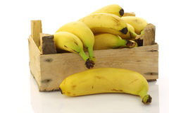 Fresh bananas in a wooden crate Stock Images