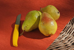 Fresh Bartlett Pears With Yellow Knife Royalty Free Stock Photos