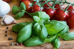 Fresh basil, cherry tomatos, garlic and pepper Royalty Free Stock Images