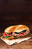 Fresh basil and ham on a crusty baguette Stock Photos