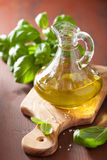 Fresh basil leaves herb and olive oil on wooden bacgkround Stock Photos