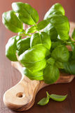 Fresh basil leaves herb on wooden background Stock Photography