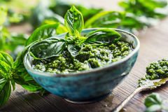 Fresh basil leaves pesto on wooden table Stock Photos