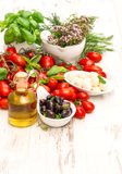 Fresh basil, tomatoes, mozzarella and olive oil. food background Royalty Free Stock Photography
