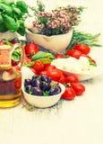 Fresh basil, tomatoes, mozzarella and olive oil. food background Royalty Free Stock Image