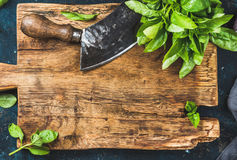 Fresh basil and vintage herb chopper on rustic wooden bord Stock Photos