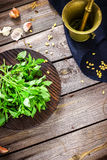 Fresh basil on wooden chopping board and  mortar Stock Photo